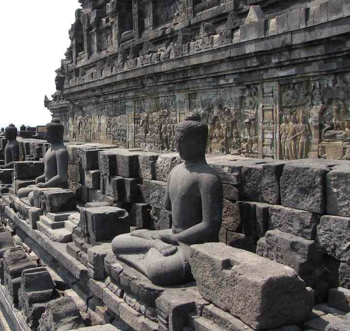 photo of Buddhas and carvings at Borobudur Buddist temple