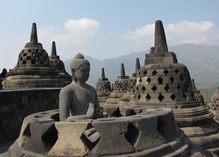 photo of open stupa with a Buddha statue at Borobudur temple in Indonesia by John Hunter.